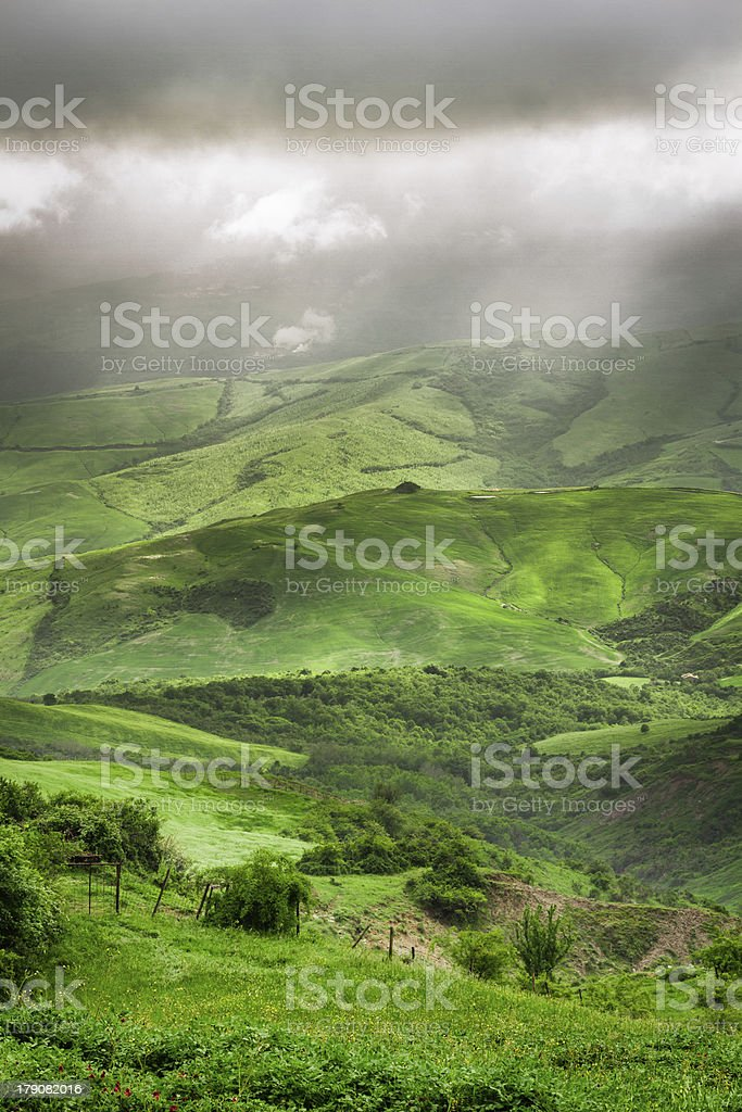 Storm clouds over the valley in Tuscany stock photo