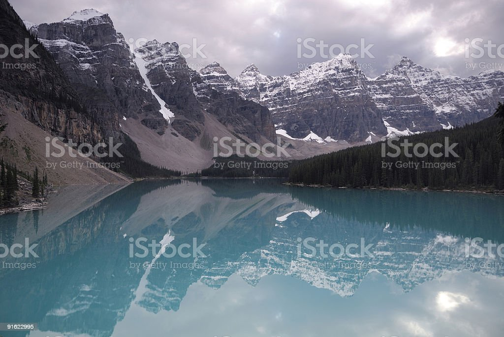 Storm clouds reflecting in Moraine Lake, Canadian Rockies royalty-free stock photo