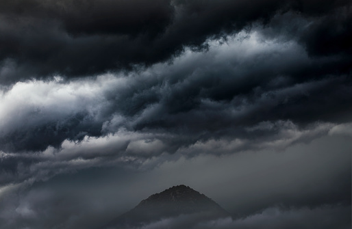 cloudy rainy sky with hill