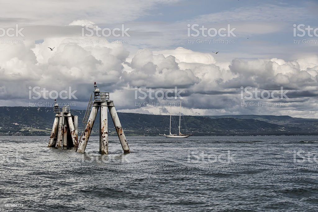 Storm clouds with sail boat stock photo
