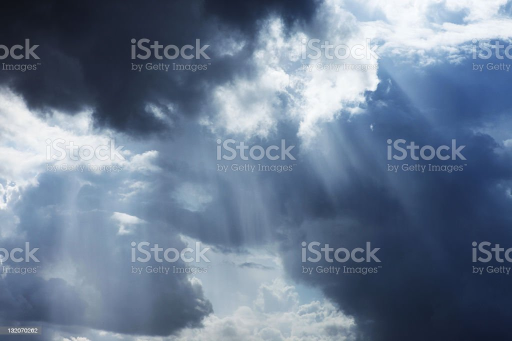 Storm cloudscape with sunbeams on a dramatic sky royalty-free stock photo