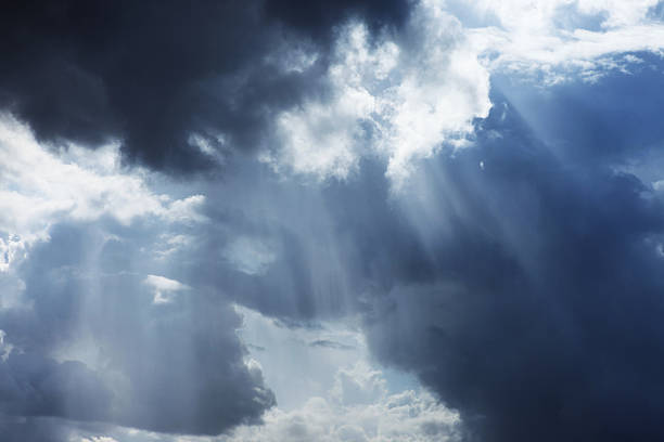 storm cloudscape with sunbeams on a dramatic sky - regen zon stockfoto's en -beelden