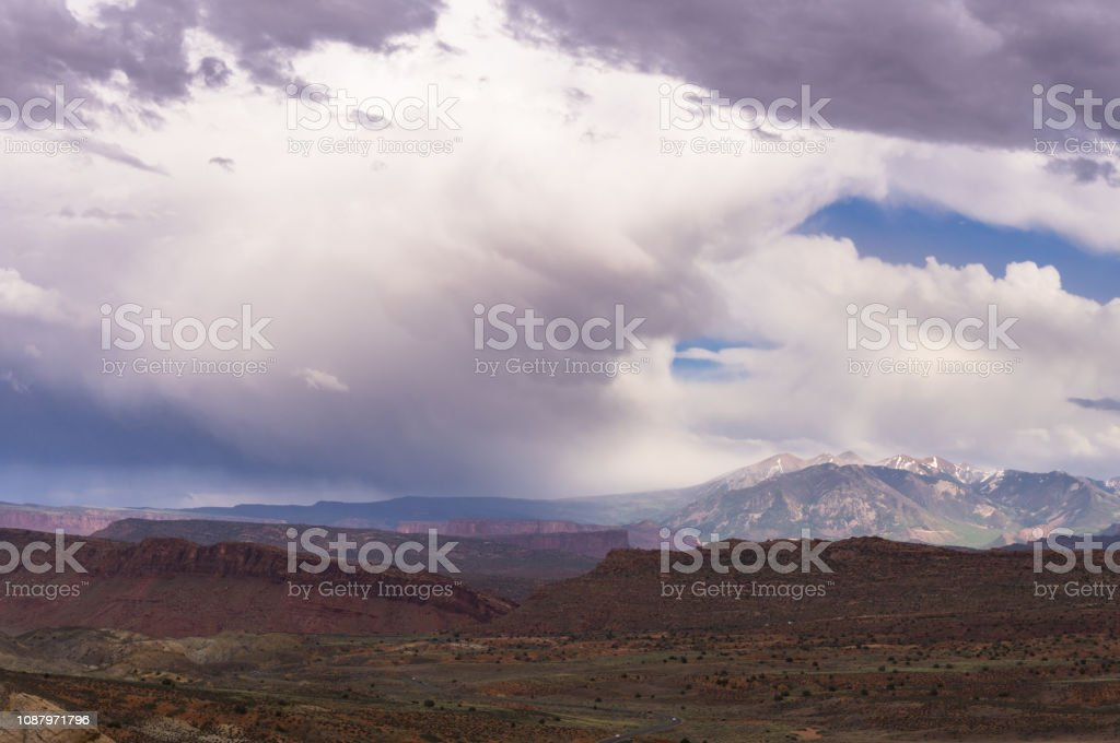 Storm Crossing Arches National Park stock photo