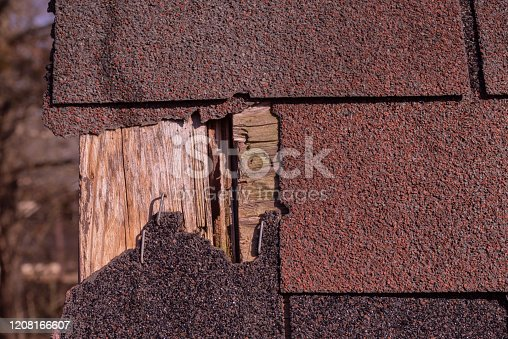 Storm damage to a shingle roof.