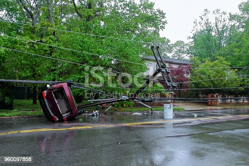 istock Storm damaged electric pole car turned over after accident 960097858