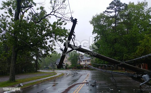 Storm damaged electric transformer on a pole and a tree damaged