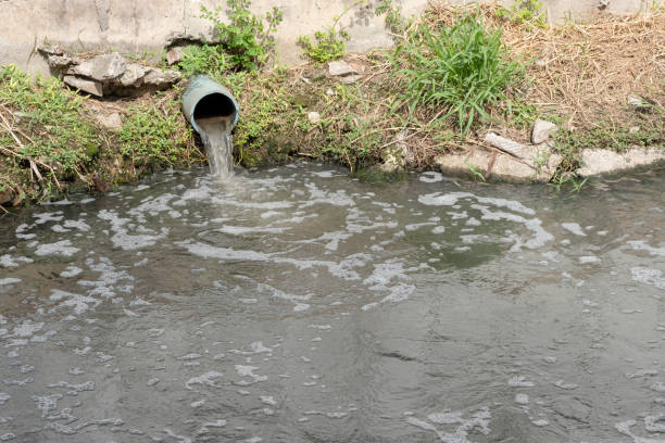 Storm Drain Outflow, stormwater, water drainage, waste water or effluent. Storm Drain Outflow, stormwater, water drainage, waste water or effluent. sewage treatment plant stock pictures, royalty-free photos & images