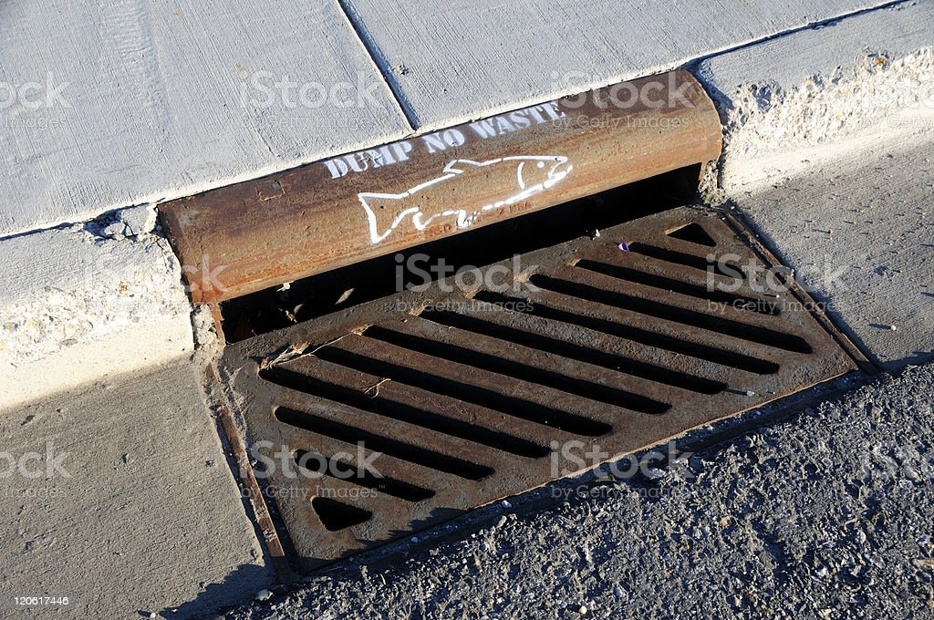 Storm Drain Pollution Warning royalty-free stock photo