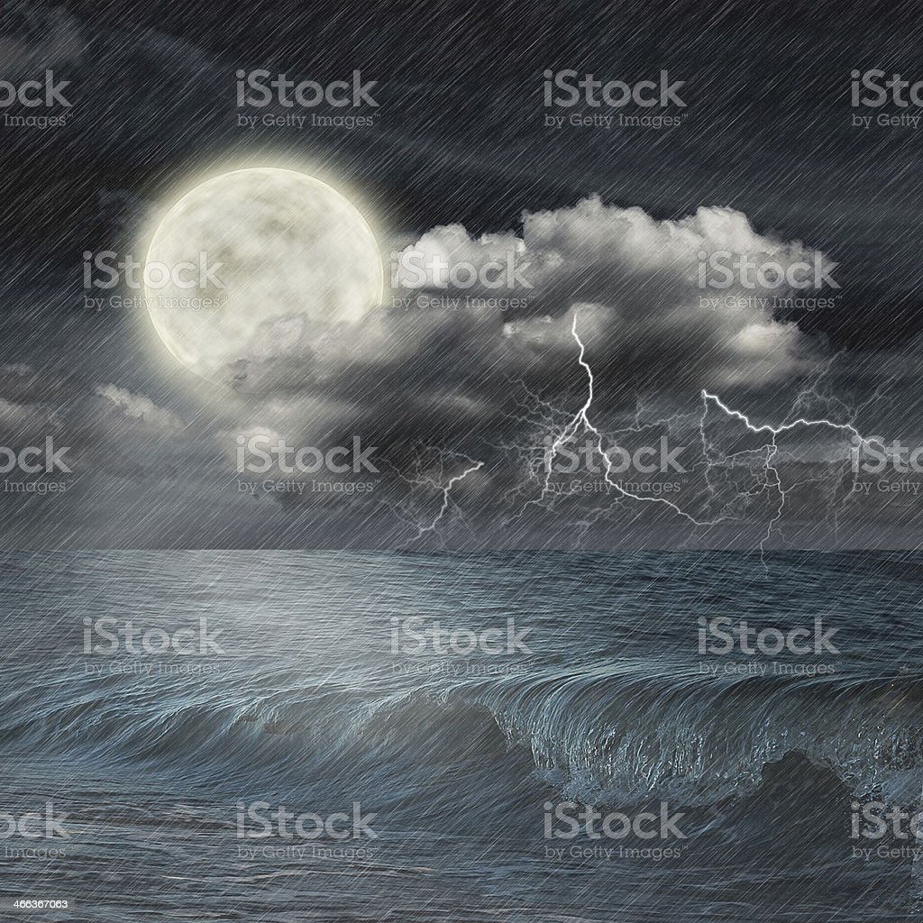 storm evening on ocean and the moon stock photo
