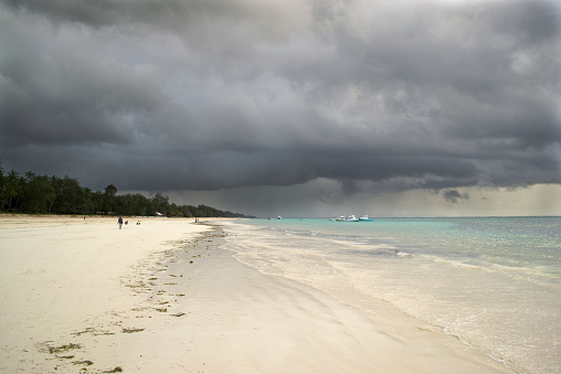 Storm gathering over a tropical beach