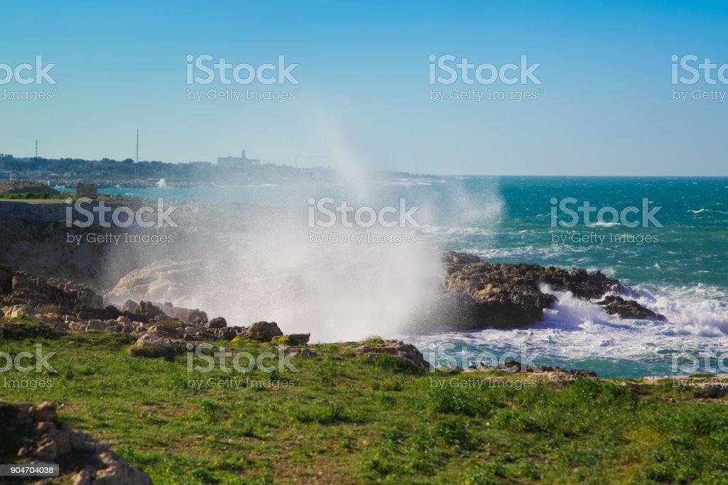 Storm on the coast of Polignano a Mare. stock photo