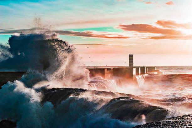 storm on the coast of the atlantic ocean in the sunshine of a pink sunset - rain clouds porto portugal imagens e fotografias de stock