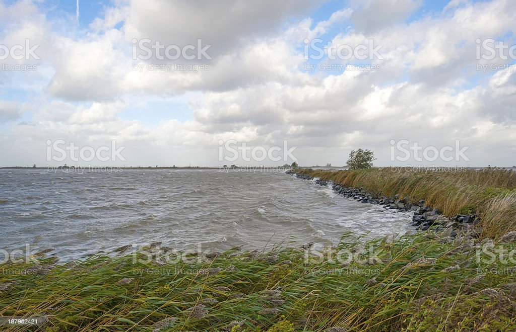 Storm over a lake at fall stock photo
