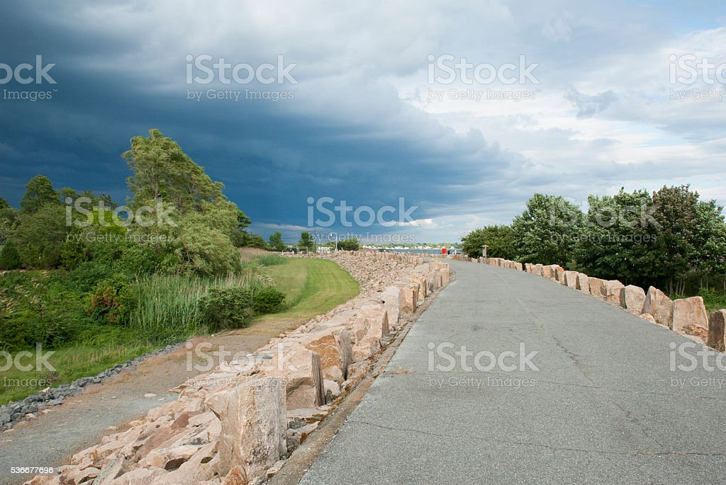 Storm over dike stock photo