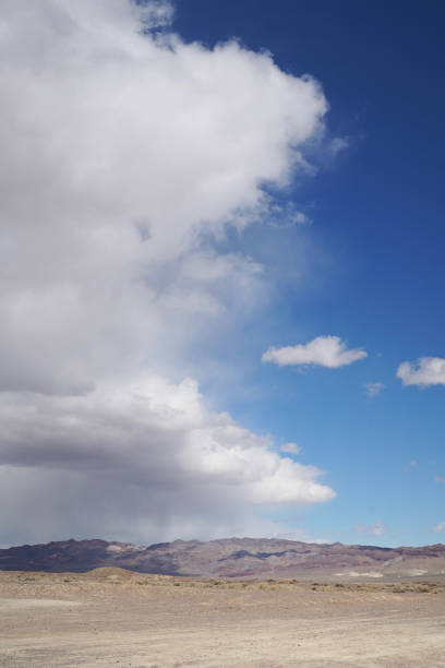 A storm over distant mountains in Fish Lake Valley stock photo