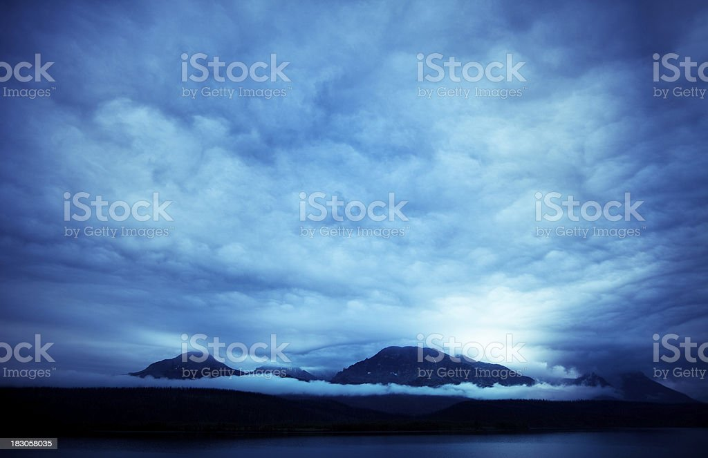 Storm over mountains in Glacier National Park royalty-free stock photo