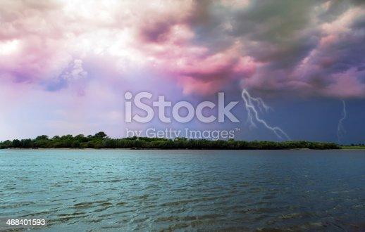 River landscape on the background of storm