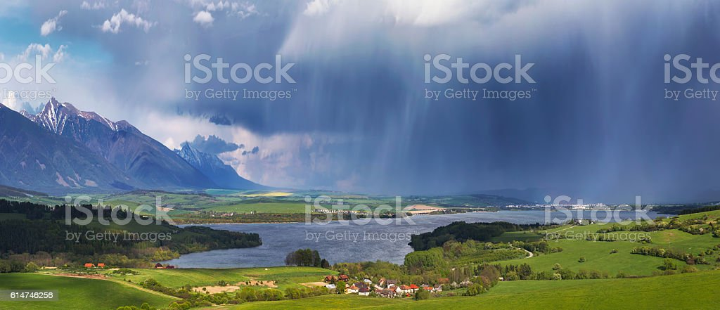 Storm over small village stock photo
