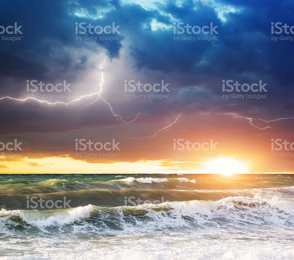 A storm over the ocean at sunset with white cap waves royalty-free stock photo