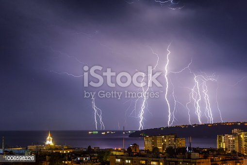 istock Storm over Varna, Bulgaria, with lightnings and flashes. 1006598326