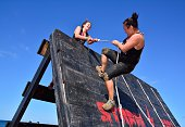 Gijon, Spain - September 19, 2015: Storm Race, an extreme obstacle course in September 19, 2015 in Gijon, Spain. Participants in extreme obstacle course jumping a wooden wall.