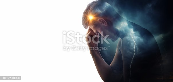 Storm sky with lightning and sun on the background of the silhouette of a man. Concept on the theme of the struggle between good and evil or the theme of medicine (migraine and headache pain ). Health and pain.