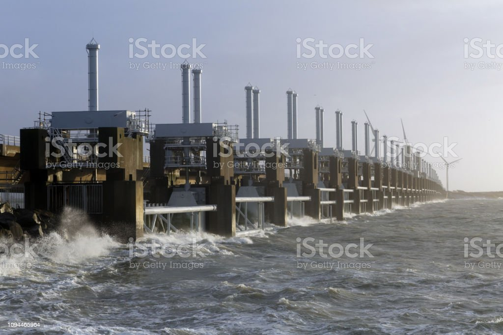 Dutch storm surge barrier in the Netherlands is a protection against...