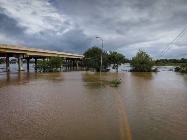 Storm surge covering flooded road stock photo