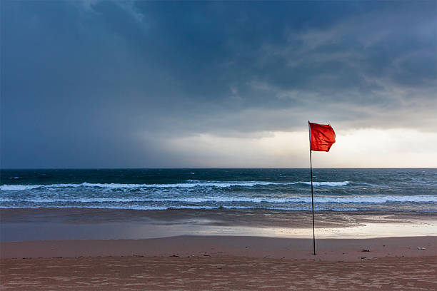 Storm warning flags on beach. Baga, Goa, India stock photo