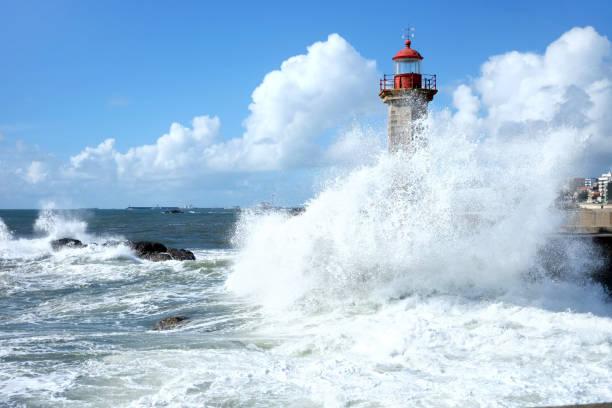 storm waves over lighthouse in porto, portugal - rain clouds porto portugal imagens e fotografias de stock