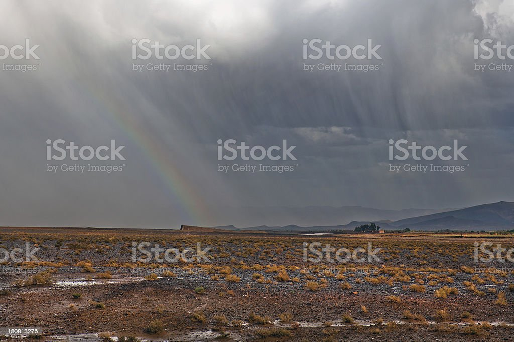 Storm with Rainbow in Moroccan Desert Africa royalty-free stock photo