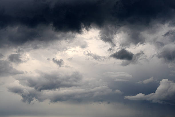 storm-cloud - dramatic sky stock photos and pictures