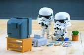 Stormtrooper figure playing the gameboy
