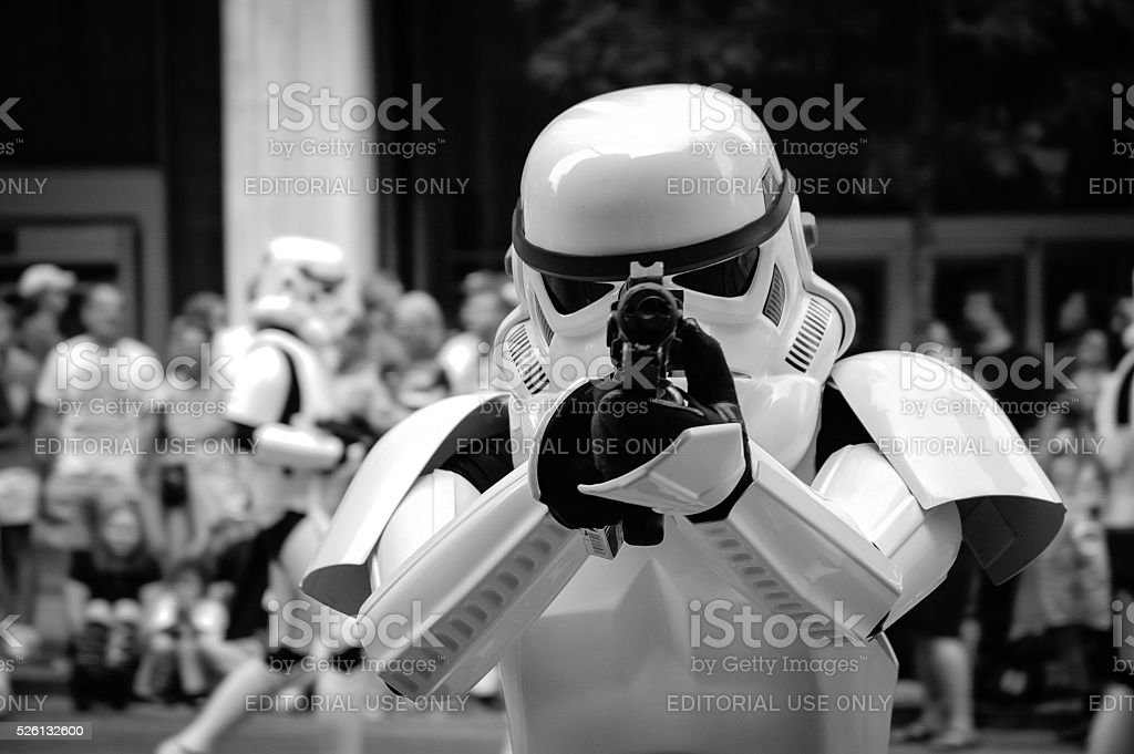 Stormtrooper pointing with his gun stock photo