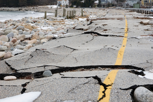 A winter storm wrecked this beach road.