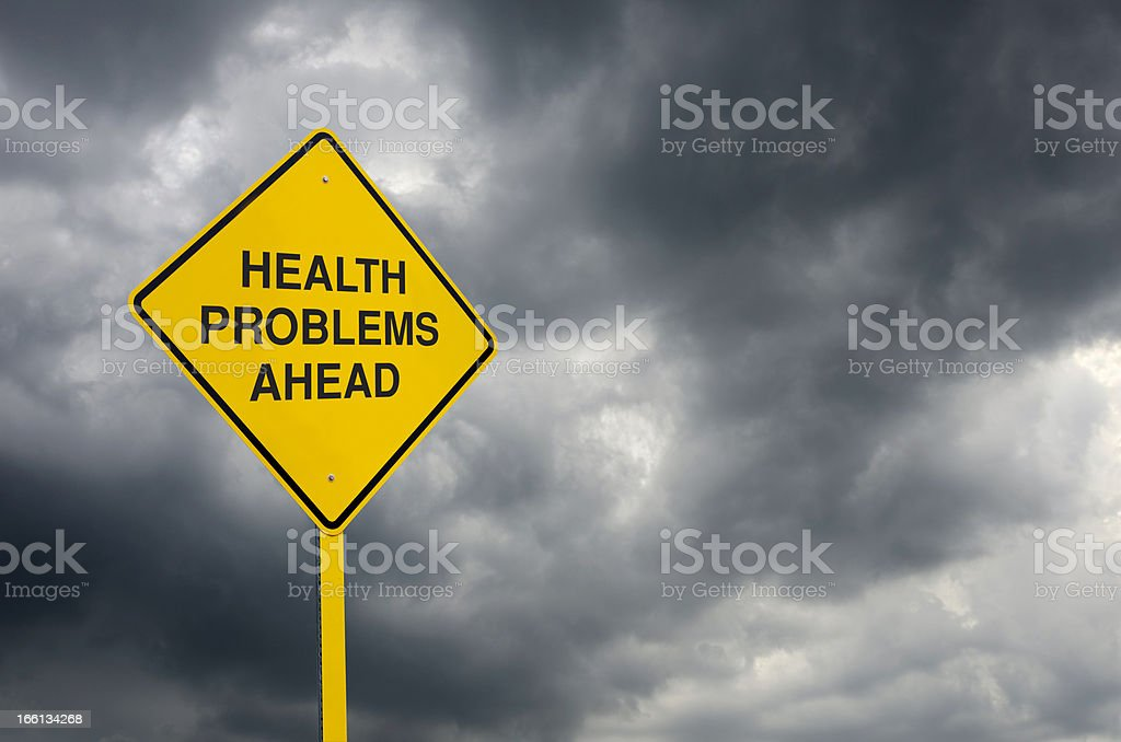 Stormy background with a health problems ahead road sign. royalty-free stock photo