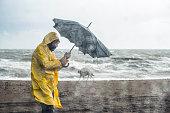 Man on stormy beach