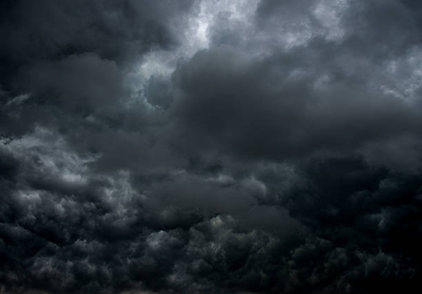 stormy clouds for background - atmospheric mood stock photos and pictures
