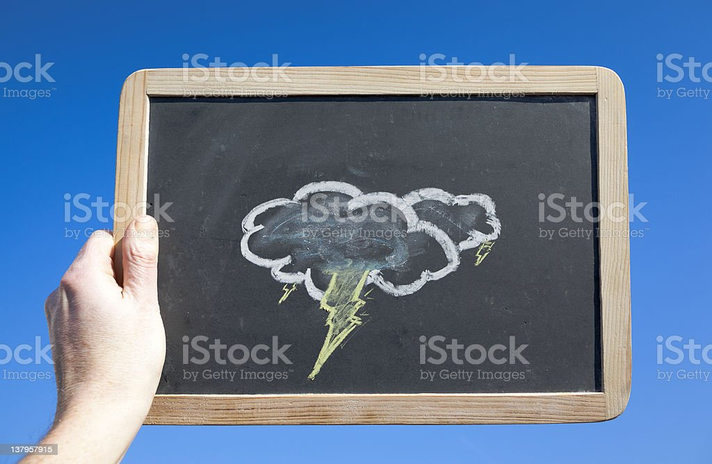 Stormy Clouds on Blackboard Against Blue Sky. Weather Concept royalty-free stock photo