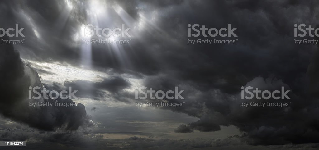 Stormy clouds with sun rays royalty-free stock photo