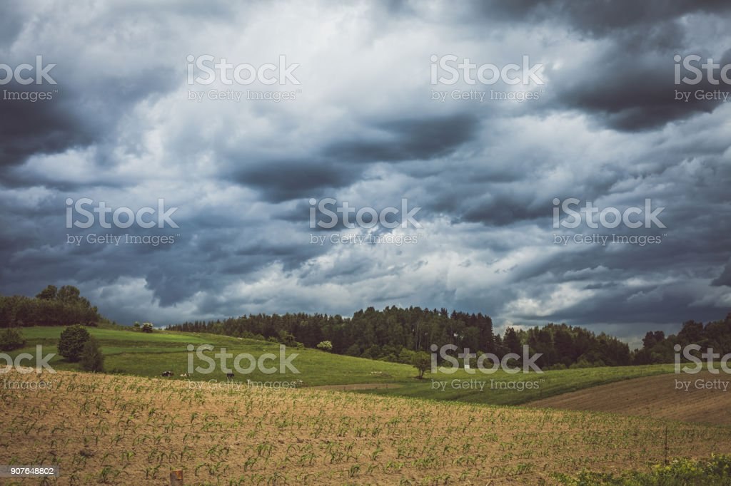 Stormy cloudscape over fields and pasture stock photo