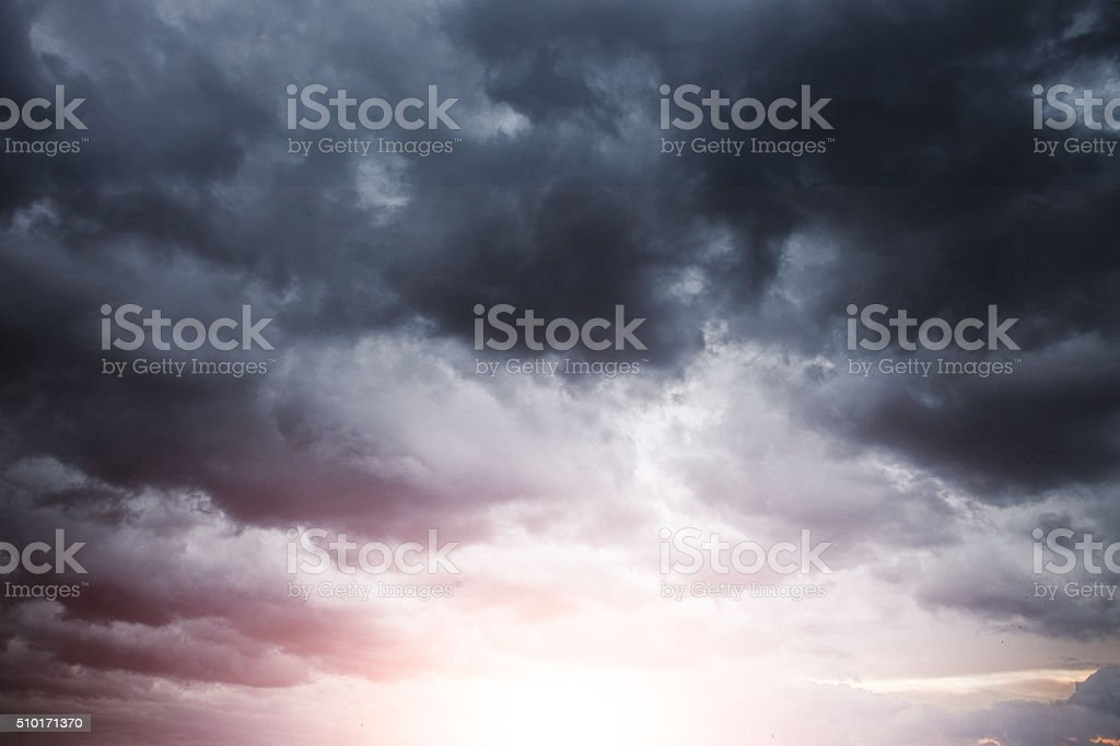 Stormy Cloudscape with sun light stock photo
