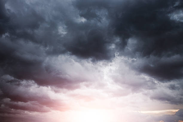 stormy cloudscape with sun light - dramatic sky stock photos and pictures