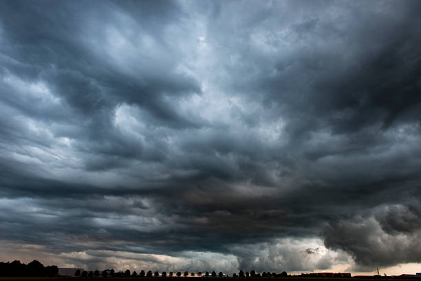 Stormy cloudy sky dramatic dangerous dark gray cloudscape stock photo