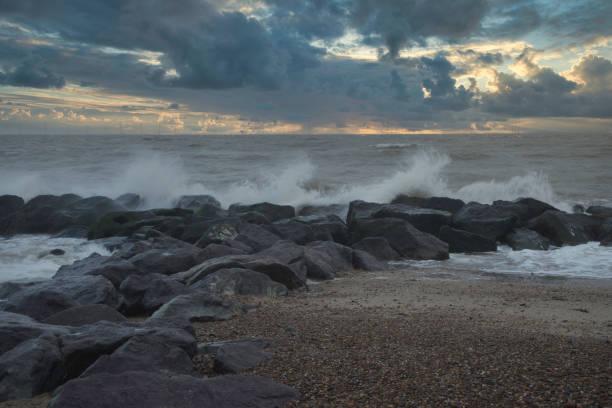 Stormy coast sunset stock photo