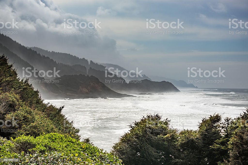 Stormy coastline in Oregon with fog and white ocean beach stock photo