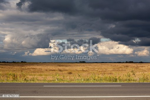 Stormy dark clouds gathering in the Hortobagy region of Hungary in autumn.