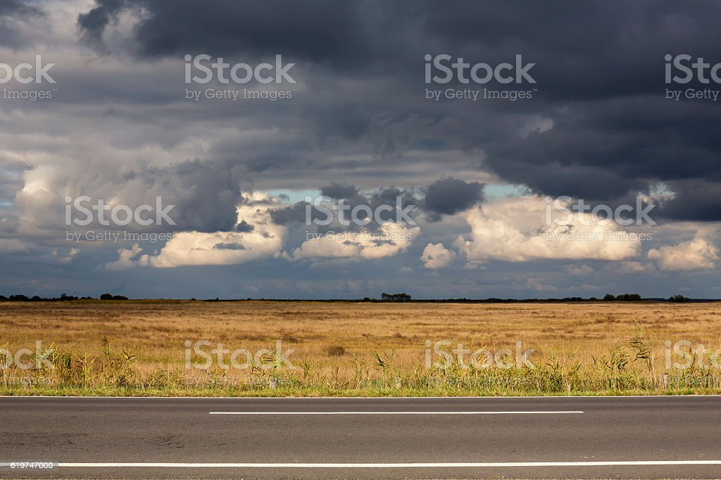 Stormy dark clouds gathering in the hungarian Hortobagy stock photo