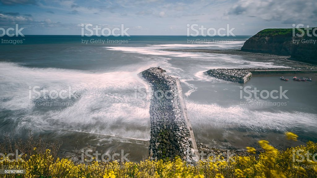 Stormy day over the harbour at Staithes, Yorkshire, UK. stock photo
