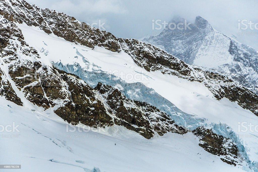 Stormy Jungfraujoch in Swiss Alps royalty-free stock photo